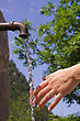 Hand Under Fresh Water stock photo