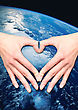 Hands In The Shape Of Heart On The Planet Ground