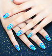 Hands With Nail Art On Spotted Background stock photo