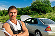 Handsome Mechanic On A Road Near The Broken Car. stock image