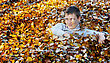 Happy Boy In Yellow And Orange Autumn Leaves stock image