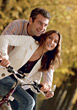 Happy Couple Riding Bikes stock photo