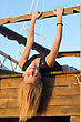 Happy Girl Lying On The Deck Of An Old Wooden Ship stock photo