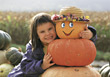 Happy Girl with Pumpkins stock image