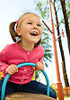 Small Happy Little Girl Is Swinging On See-saw stock photo