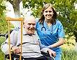 Happy Old Patient With Supporting Doctor At The Nursing Home stock photo
