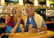 Happy Older Couple Drinking Cocktails stock image