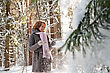 Happy Red-haired Woman Having Fun On Winters Day In Forest stock photography