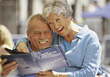 Happy Senior Couple Looking at a Menu stock photography