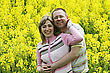 Happy And Smiling Middle-aged Couple In The Flower Meadow