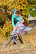 Happy Young Couple Dancing In The Park stock photo