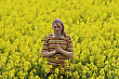Happy Young Man In The Yellow Flower Meadow stock photo