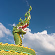 Head Of Asian Dragon On The Cloudy Sky Background stock photography