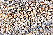 Hardwood Heap Of Firewoods As Background . Close - Up . stock photography