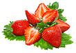 Heap Of Fresh Strawberries On Green Foliage . Isolated stock photography