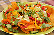 Heap Of Nachos With Vegetables On Green Plate stock image