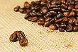 Heap Of The Roasted Coffee Beans Over Yellow Background