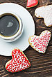 Decorated Heart Shaped Cookies Baked On Valentines Day And A Cup Of Coffee. Focus On Biscuits stock photography