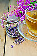 Herbal Tea In A Glass Cup, Metal Sieve With Dry Flowers Fireweed, Fireweed Fresh Flowers On A Wooden Board stock photography