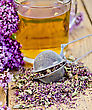 Herbal Tea In Glass Mug, Metal Sieve With Dry Flowers Marjoram, Fresh Flowers Of Oregano On The Background Of Wooden Boards