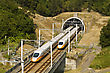 High Speed Commuter Train Driving Across Tunnel With Mountain Scenery stock photography