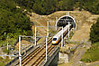 Suburban High Speed Train Driving Across Tunnel With Mountain Scenery stock photography