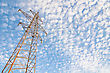 High-voltage Power Tower Over Blue Sky stock photo