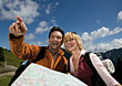 Hiking Couple Followig Map Directions stock photography