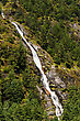 Hiking Himalaya Landscape: Waterfall And Forest Trees. Travel To Nepal stock photo