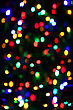 Holiday Background From Unfocused Color Lights stock image