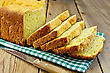 Homemade Bread Yellow On A Green Napkin, Knife On The Background Of Wooden Boards stock photo