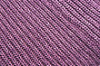 Violet Homemade Knitwear As A Background. stock photography