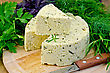 Homemade Round Cheese With Herbs And Spices, Knife, Parsley, Basil, Dill, Tarragon, Rosemary On A Wooden Board