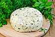 Homemade Round Cheese With Herbs And Spices On A Wooden Board stock photography