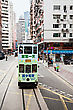 Kowloon HONG KONG - FEBRUARY 21: Double Tram With Advertisements At Hennessy Rd. Road Show Provides Advertisements To The Passengers Of Public Vehicles On Febuary 21,2013 In Hong Kong stock photo