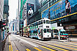 HONG KONG - FEBRUARY 21: Double Trams With Advertisements At Hennessy Rd. Road Show Provides Advertisements To The Passengers Of Public Vehicles On Febuary 21,2013 In Hong Kong stock image