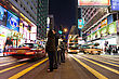 HONG KONG - FEBRUARY 21: Unidentified People Crossing The Street On February 21, 2013 In Hong Kong. With A 7 Million People, Hong Kong Is One Of The Most Densely Populated Areas In The World stock image