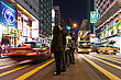HONG KONG - FEBRUARY 21: Unidentified People Crossing The Street On February 21, 2013 In Hong Kong. With A 7 Million People, Hong Kong Is One Of The Most Densely Populated Areas In The World stock photography