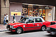 Architecture HONG KONG - MARCH 19: Taxis On The Street On March 19, 2013 In Hong Kong. Over 90% Daily Travelers Use Public Transport. Its The Highest Rank In The World stock image