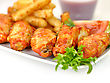 Hot Chicken Wings With Fried Potatoes And Sauce stock photo