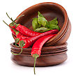 Hot Red Chili Or Chilli Pepper In Wooden Bowls Stack Isolated On White Background Cutout stock photography