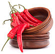 Hot Red Chili Or Chilli Pepper In Wooden Bowls Stack Isolated On White Background Cutout stock image