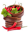Hot Red Chili Or Chilli Pepper In Wooden Bowls Stack Isolated On White Background Cutout stock photo
