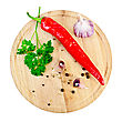 Hot Red Pepper, Garlic, Parsley, Peppercorns And Mustard On A Circular Wooden Board stock image