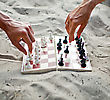 Human Hands With Chess Figure Making Move stock photo