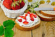 Hunk Of Bread With Cottage Cheese Cream, Strawberries, A Basket With Berries, Leaf, Flower Daisies On A Background Of Wooden Boards