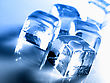 Ice Cube Over Abstract Blue Backgrounds