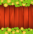 Illustration Clovers And Golden Coins On Brown Wooden Background For St. Patrick's Day - Vector