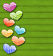 Illustration Multicolored Striped Hearts On Green Wooden Texture For Valentine Day - Vector