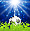 Illustration Soccer Ball On Green Grass With Shine Effect - Vector
